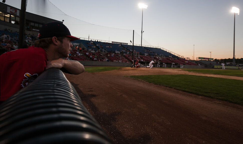 Pitcher Craig James watches a hit from an Explorer during the Sunday game in Sioux City. (Melissa Tait / Winnipeg Free Press)