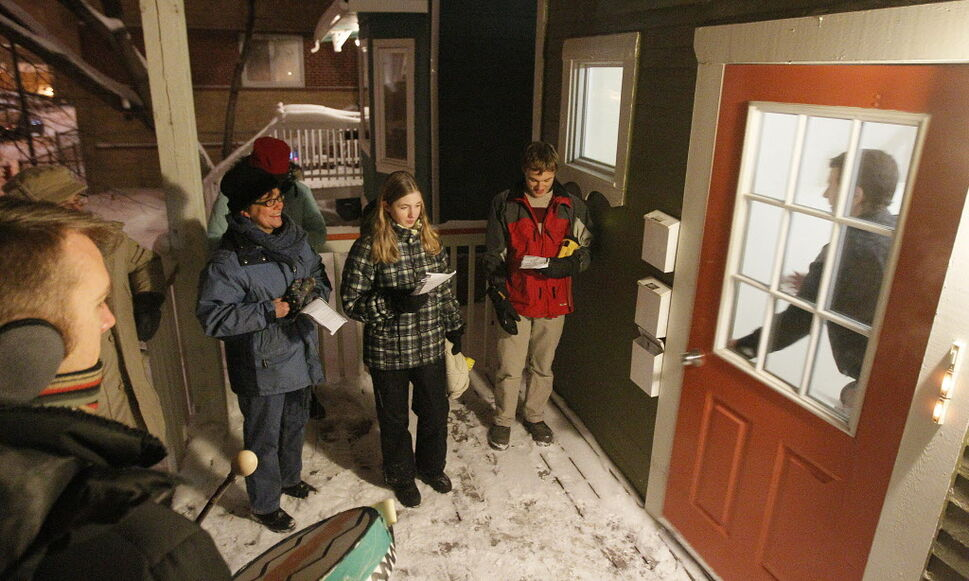 Members of West Broadway Community Ministry stop at Kelly Ross' West Broadway house in the Mexican tradition of La Posada on Tuesday evening. (John Woods / Winnipeg Free Press)