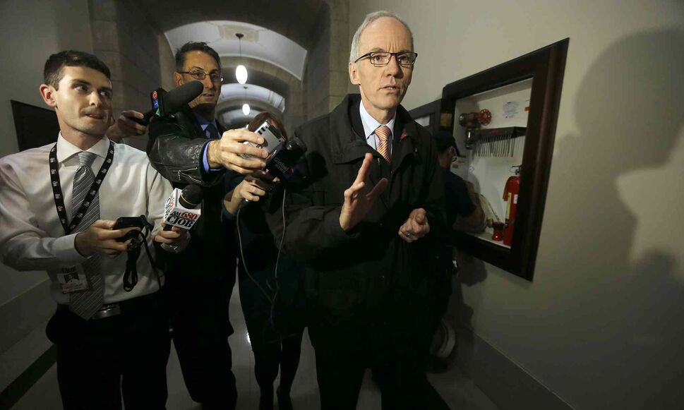 Transportation Minister Steve Ashton is hounded by a few reporters as he walks in the halls of the legislature. Ashton lost the leadership bid in 2009 to Greg Selinger. He was not one of the five dissidents who demanded Selinger resign. He was also not at a news conference Selinger held to announce he would not quit. Ashton is seen as a certain candidate if the party held a leadership race. (Ken Gigliotti / Winnipeg Free Press)