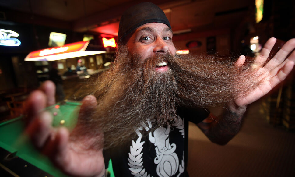 Don McPhail shows off his beard at an evening meeting of the Manitoba Facial Hair Club. April 14, 2014  (Phil Hossack / Winnipeg Free Press)
