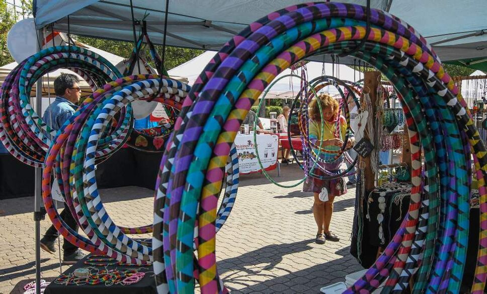 Karen Turnbull (right) of Kazual art&soul puts out her homemade hula hoops at the Farmers Market at The Forks Sunday morning. July 30, 2014  (MIKE DEAL / WINNIPEG FREE PRESS)