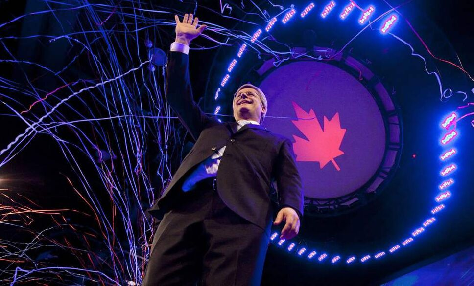 Prime Minister Stephen Harper waves to the crowd following his speech during election night in Calgary, Alta, Monday, May 2, 2011.  THE CANADIAN PRESS/Jonathan Hayward