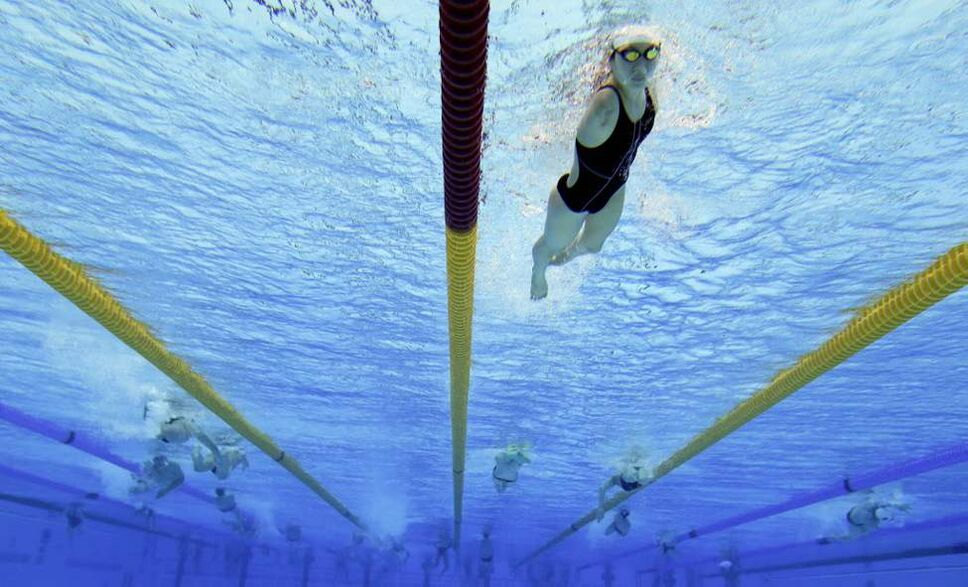 Swimmers train in the Aquatic Center ahead of the 2012 Paralympics Olympics, in London. The Paralympic opening ceremony will be held at the Olympic Park in London on Wednesday. (AP Photo/Kirsty Wigglesworth)