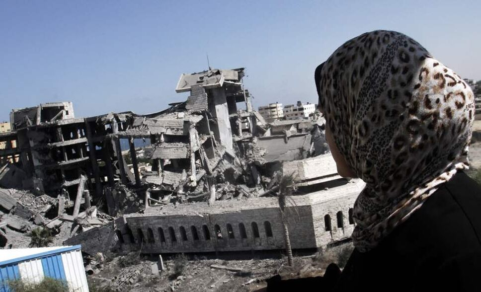 A Palestinian woman looks at the destroyed Hamas training camp following an Israeli airstrike in Gaza City. An Israeli aircraft attacked three Hamas training camps in the Gaza Strip, causing no injuries, eyewitnesses said. (AP Photo/Hatem Moussa)