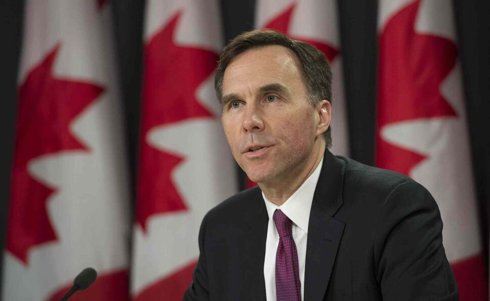 Minister of Finance Bill Morneau speaks to media as he delivers a fiscal update during a news conference, in Ottawa. (CP)