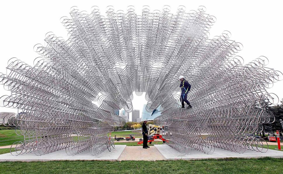 Workers put the finishing touches on Ai Weiwei's Forever Bicycles at The Forks on Thursday afternoon. (PHIL HOSSACK / WINNIPEG FREE PRESS)