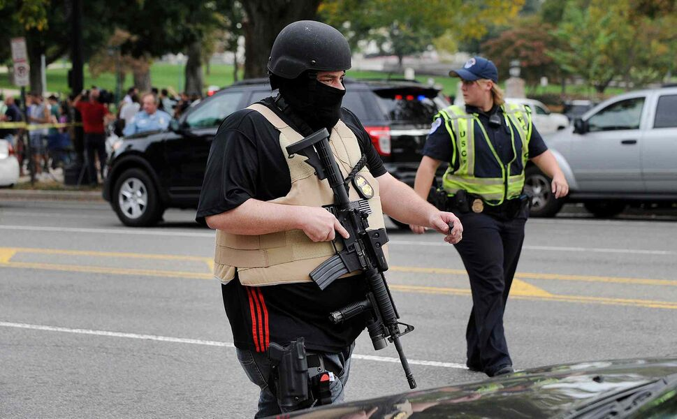 Heavily armed police secured the scene following the incident. (Olivier Douliery / MCT)