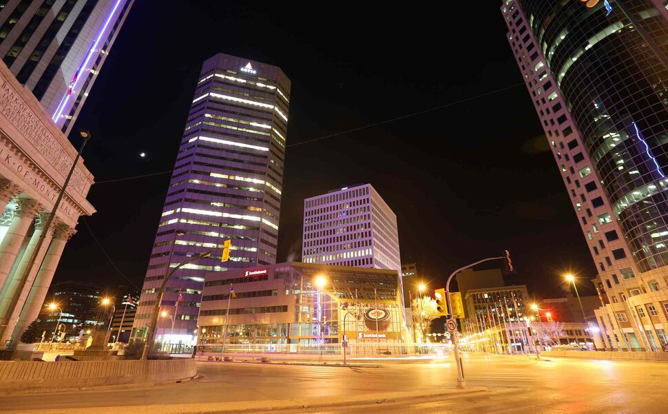 Total lunar eclipses occur twice a year but are not visible everywhere on Earth at the same time. Above Portage and Main, a full moon becomes a blood moon. (Trevor Hagan / Winnipeg Free Press)
