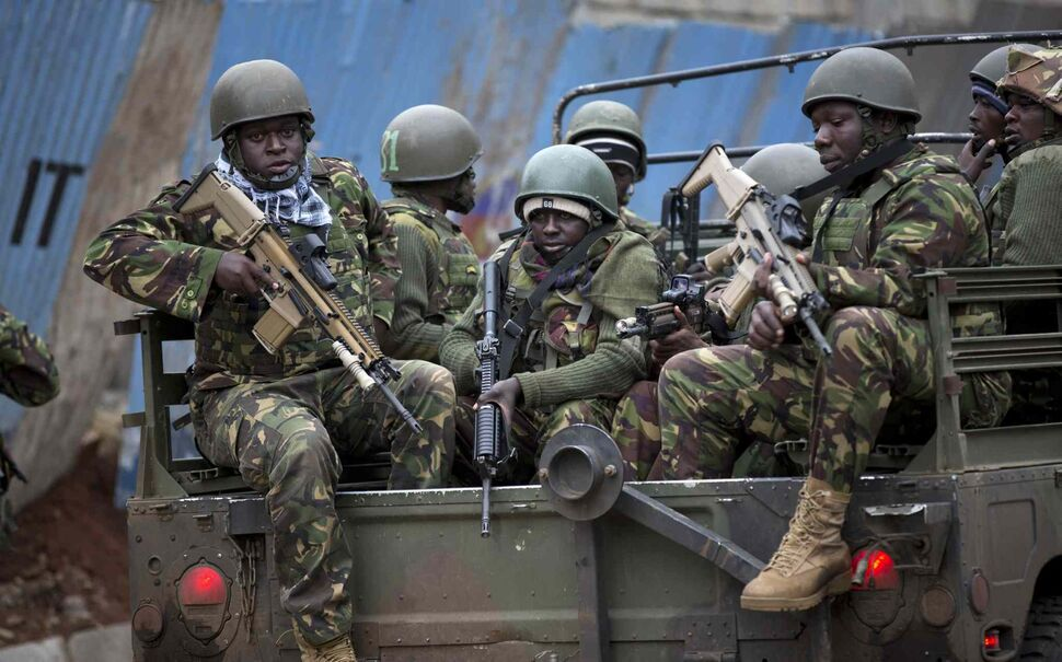 Trucks of soldiers from the Kenya Defence Forces arrive after dawn outside the Westgate Mall in Nairobi, Kenya Sunday. Islamic extremist gunmen lobbed grenades and fired assault rifles inside Nairobi's top mall Saturday, killing dozens and wounding more than 100 in the attack. Early Sunday morning, 12 hours after the attack began, gunmen remained holed up inside the mall with an unknown number of hostages.  (Ben Curtis / The Associated Press)