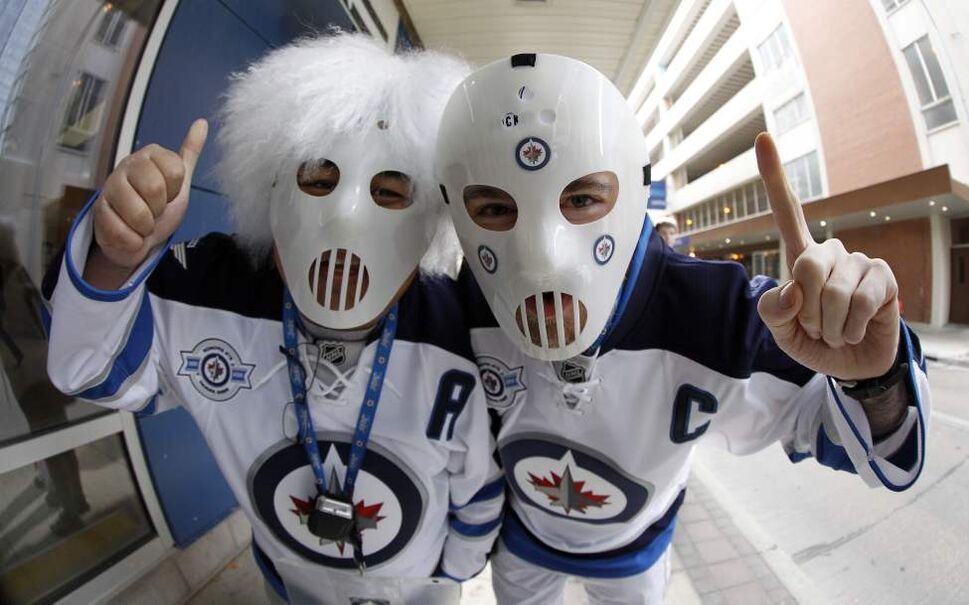 Edgar Purganan and Keith Lavallee outside the MTS Centre. (Trevor Hagan / Winnipeg Free Press)
