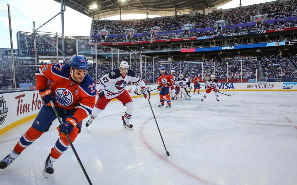 The Winnipeg Jets' Tyler Myers (57) chases Edmonton Oilers' Milan Lucic (27) in second period action at Investors Group Field Sunday.  (MIKE DEAL / WINNIPEG FREE PRESS)