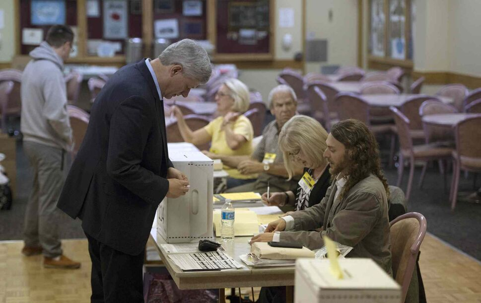 Conservative leader Stephen Harper casts his ballot at an Elections Canada poling station in Calgary Monday, Oct. 19, 2015.  THE CANADIAN PRESS/Jonathan Hayward (CP)