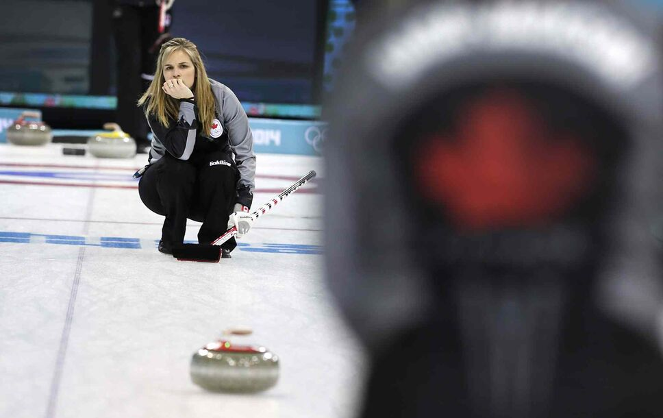 Jennifer Jones watches a rock during a training session at the 2014 Winter Olympics. (Wong Maye-E / The Associated Press)