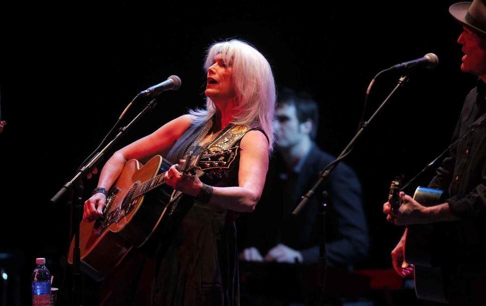 Singer-songwriters Emmylou Harris (left) and Rodney Crowell perform at the Burton Cummings Theatre Thursday night. (BORIS MINKEVICH / WINNIPEG FREE PRE)