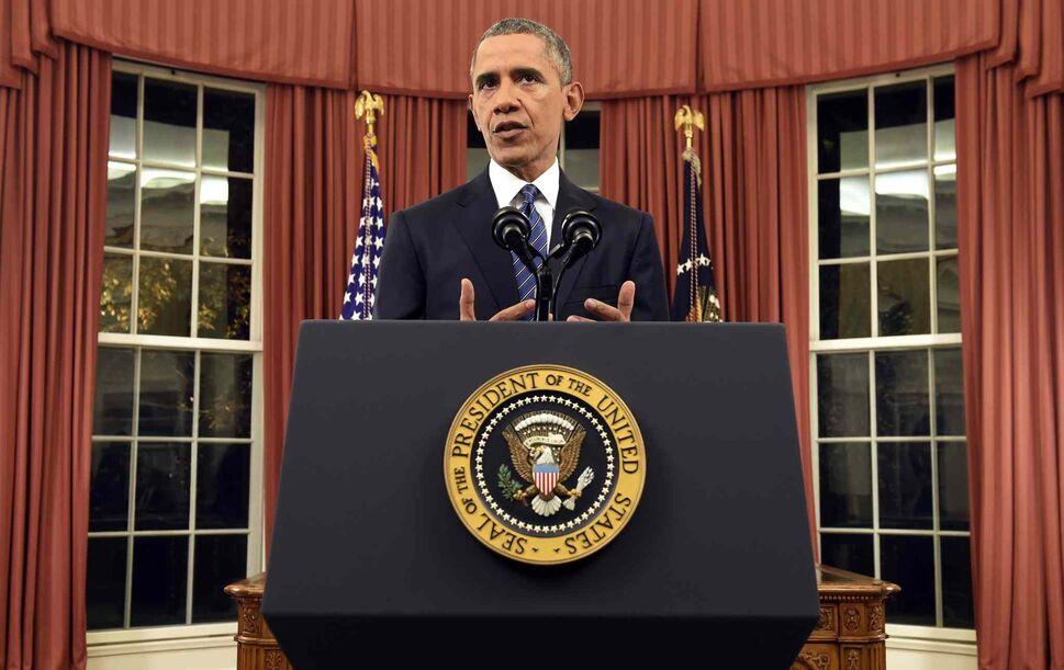 President Barack Obama addresses the nation from the Oval Office at the White House in 2015.  (Saul Loeb / The Associated Press)