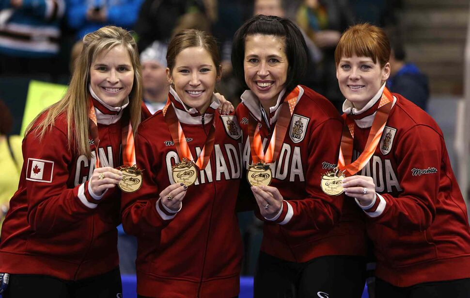 From left: skip Jennifer Jones and her team, Kaitlyn Lawes, Jill Officer and Dawn McEwen show off the spoils of victory. (Jason Halstead / Winnipeg Free Press)