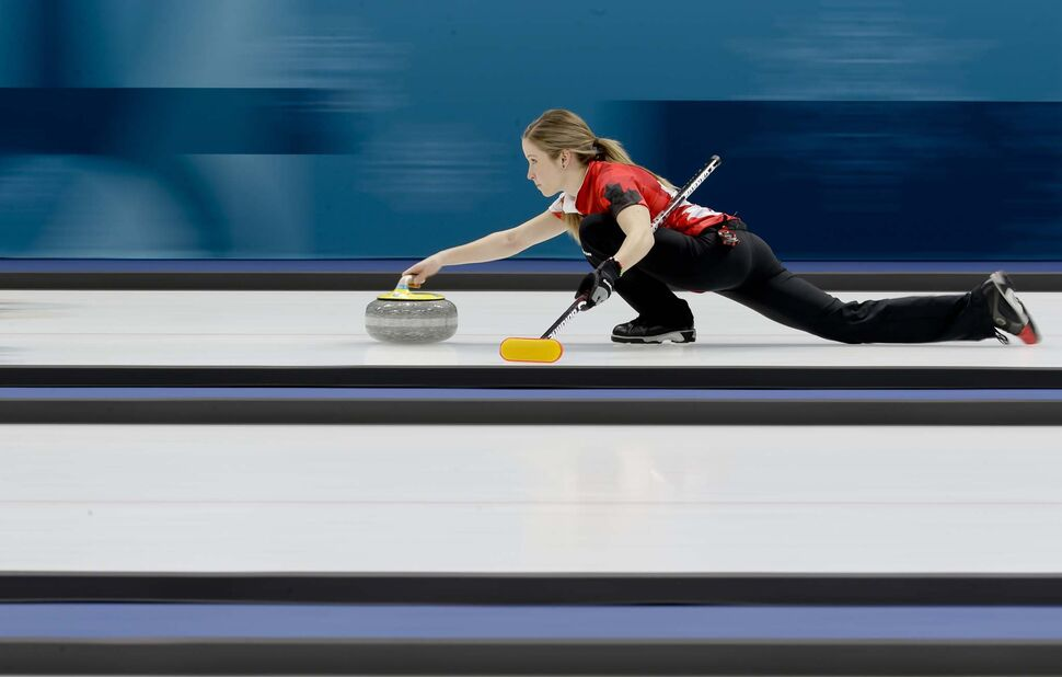 NATACHA PISARENKO / THE ASSOCIATED PRESS</p><p>Canada's Kaitlyn Lawes throws a stone during a mixed doubles curling match against South Korea's Jang Hyeji and Lee Kijeong at the 2018 Winter Olympics in Gangneung, South Korea, Sunday, Feb. 11, 2018.