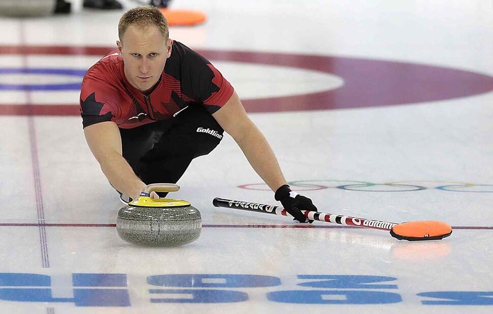 Canada's Brad Jacobs tests the ice during the training session at the 2014 Winter Olympics. (Wong Maye-E)
