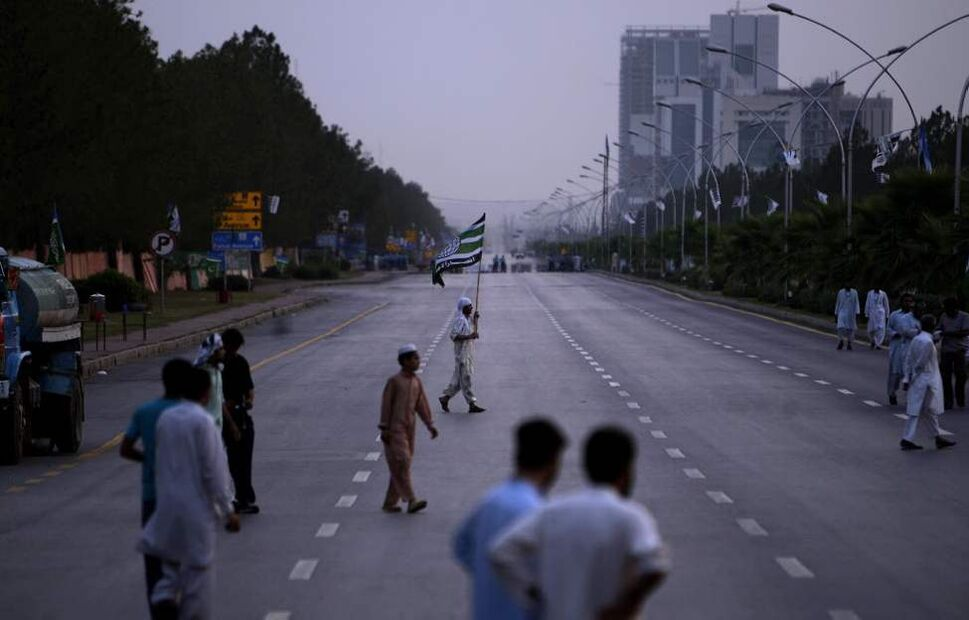 Protesters in Islamabad, Pakistan, for wait the arrival of others to attend a rally condemning the movement of NATO supplies to Afghanistan through Pakistan. (AP Photo/Muhammed Muheisen)