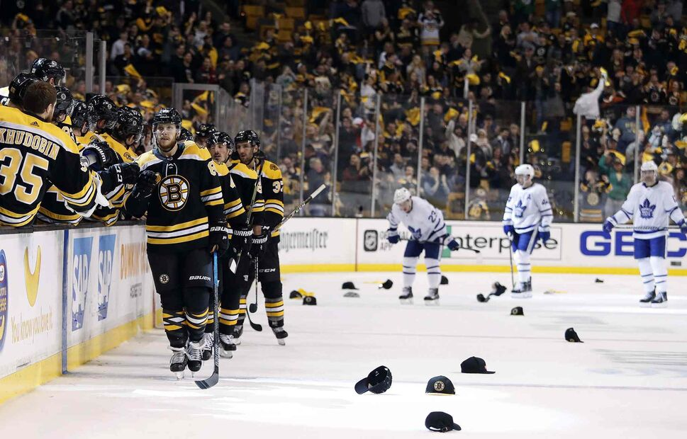 Boston's David Pastrnak is congratulated after scoring his third goal of the night against Toronto. (Winslow Townson / The Associated Press)