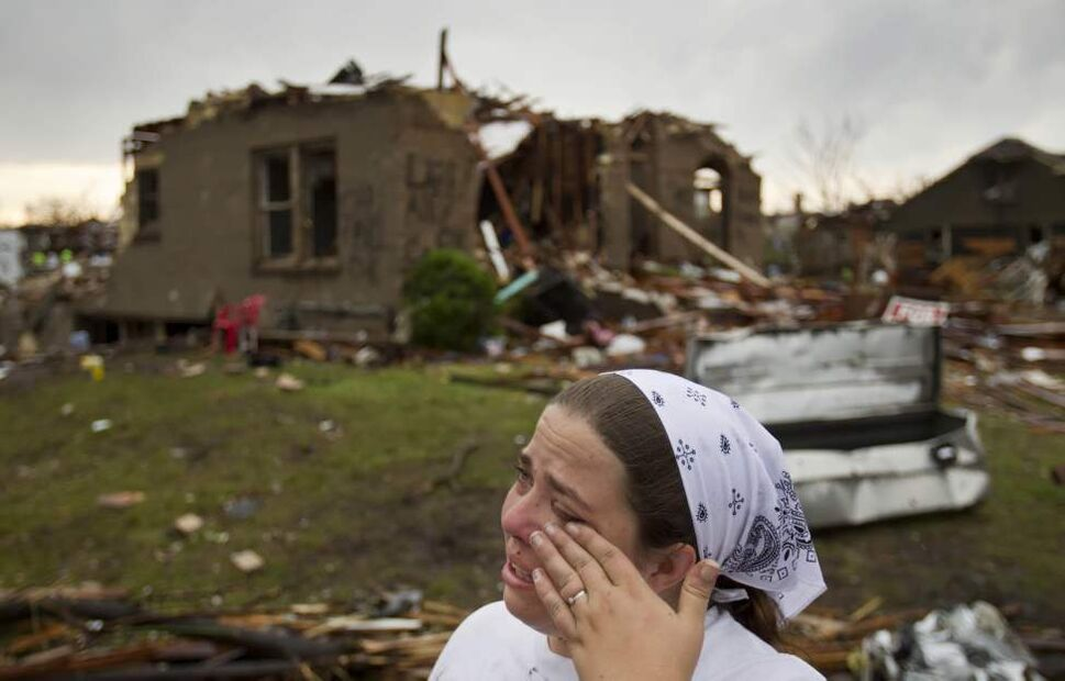 While her Joplin, Missouri home was completely destroyed, Amy Jump, her husband and three children all survived the tornado which devastated the city Sunday evening. Here, Jump is emotional as she and her neighbors sift through the rubble Monday morning, May 23, 2011, looking for salvageable items and photos. (David Eulitt/Kansas City Star/MCT)