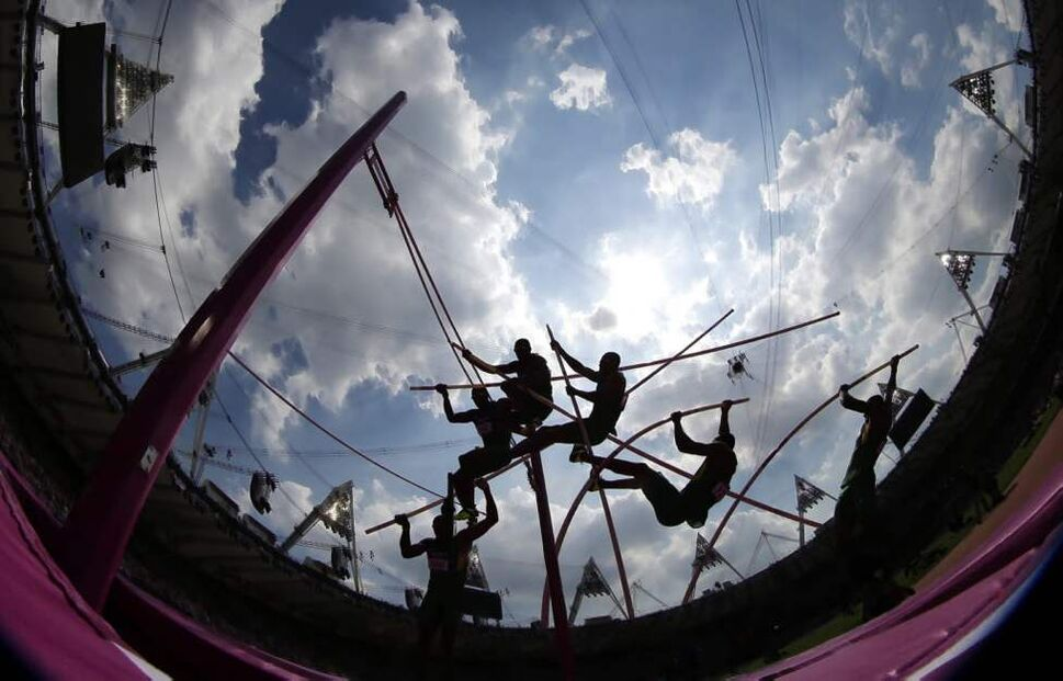 In this multiple exposure photo, Canada's Damian Warner competes in the men's decathlon pole vault at the 2012 Summer Olympics. (AP Photo/David J. Phillip )