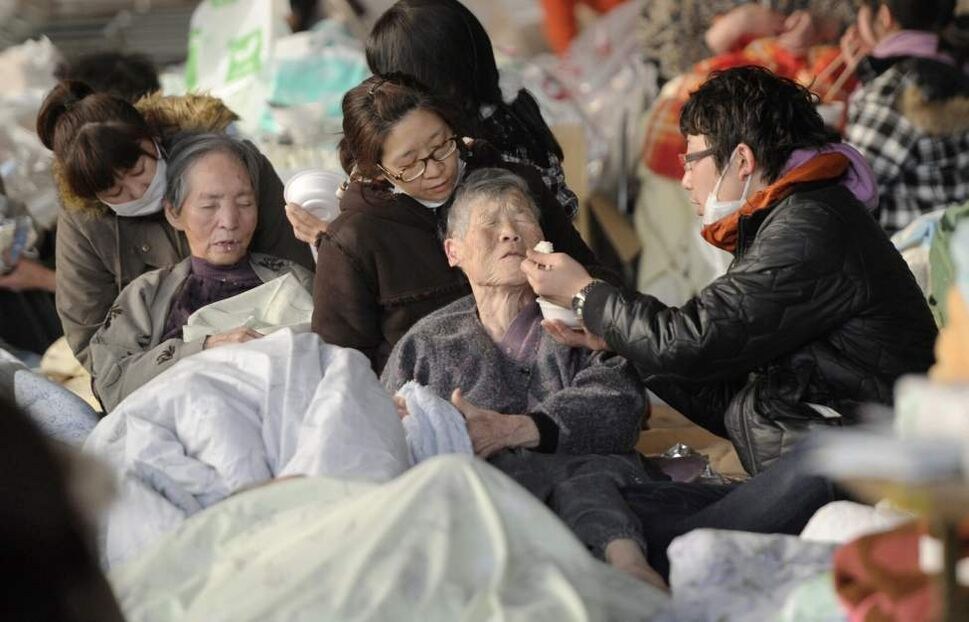 Elderly persons are helped to eat at an evacuation center in Kesennuma, Miyagi Prefecture, northern Japan, Sunday, March 13, 2011, two days after a powerful earthquake-triggered tsunami hit the country's east coast. (AP Photo/Kyodo News)