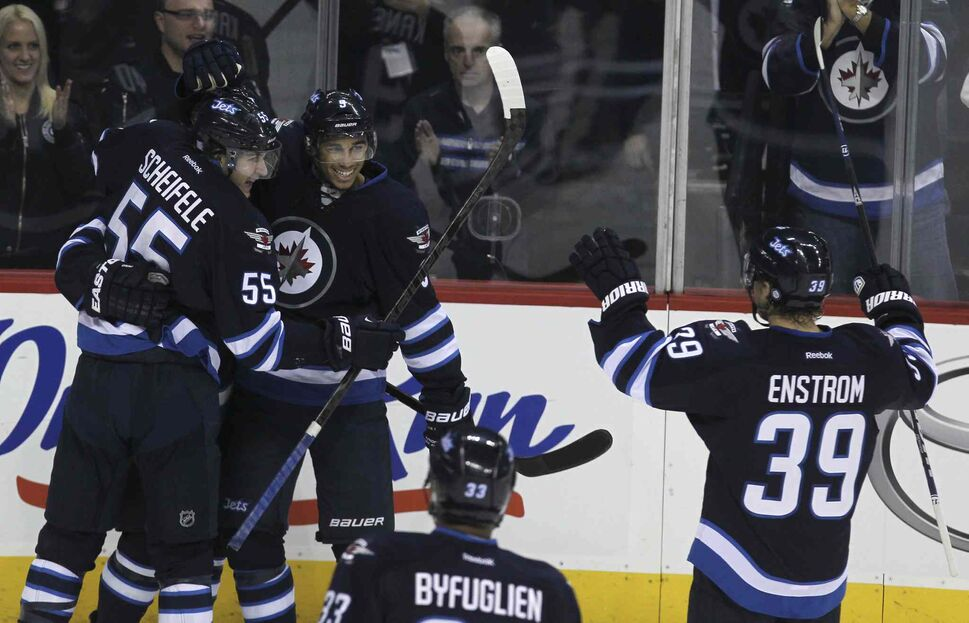 Winnipeg Jets' Evander Kane (9) and Mark Sheifele (55) celebrate after a third-period goal. (MIKE DEAL / WINNIPEG FREE PRESS)