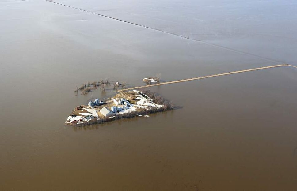 A farm is surrounded by the flooding Red River between the towns of St Jean Baptiste  and Morris. JOE BRYKSA/WINNIPEG FREE PRESS