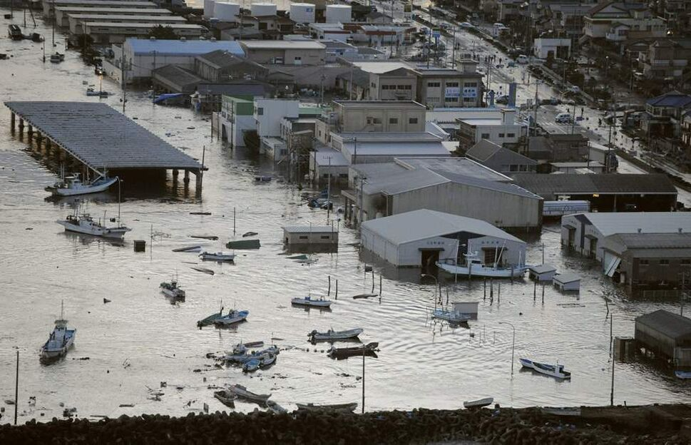 A port is submerged after a tsunami spawned by a powerful earthquake in Oarai town, Ibaraki prefecture (state), Japan, Friday, March 11, 2011. The powerful tsunami spawned by the largest earthquake in Japan's recorded history slammed the eastern coast Friday, sweeping away boats, cars, homes and people. (AP Photo/Kyodo News)