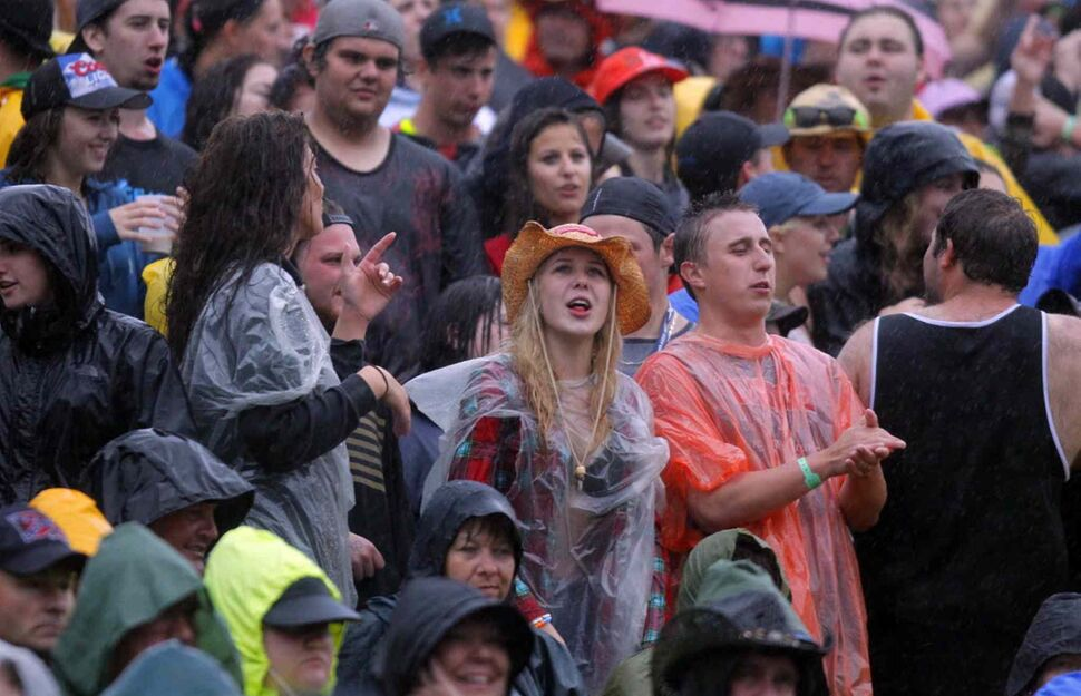 Dedicated, wet fans watch Dallas Smith performs second last Saturday night.   ( BORIS MINKEVICH / WINNIPEG FREE PRESS)