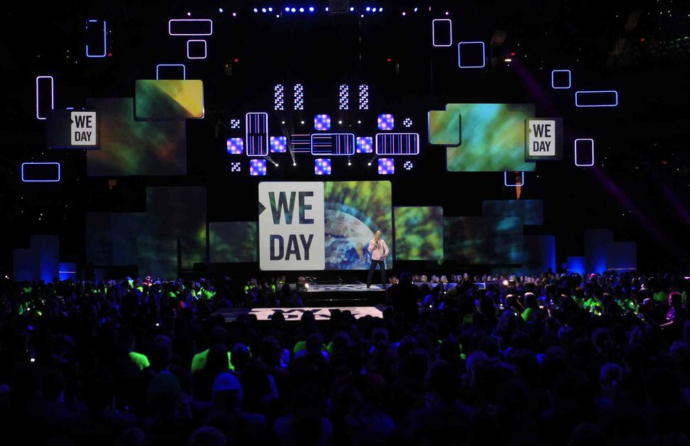 Winnipeg Free Press editor Paul Samyn addresses the We Day crowd. (Wayne Glowacki / Winnipeg Free Press)