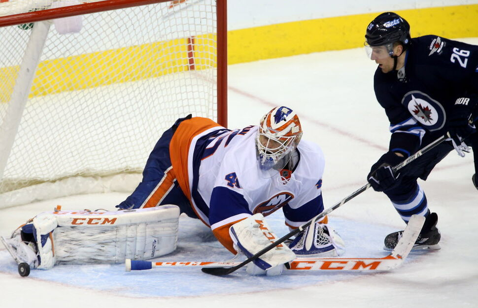 New York Islanders goalie Anders Nilsson makes a toe save against Winnipeg Jets' Blake Wheeler late in the third period. (Trevor Hagan / The Canadian Press)