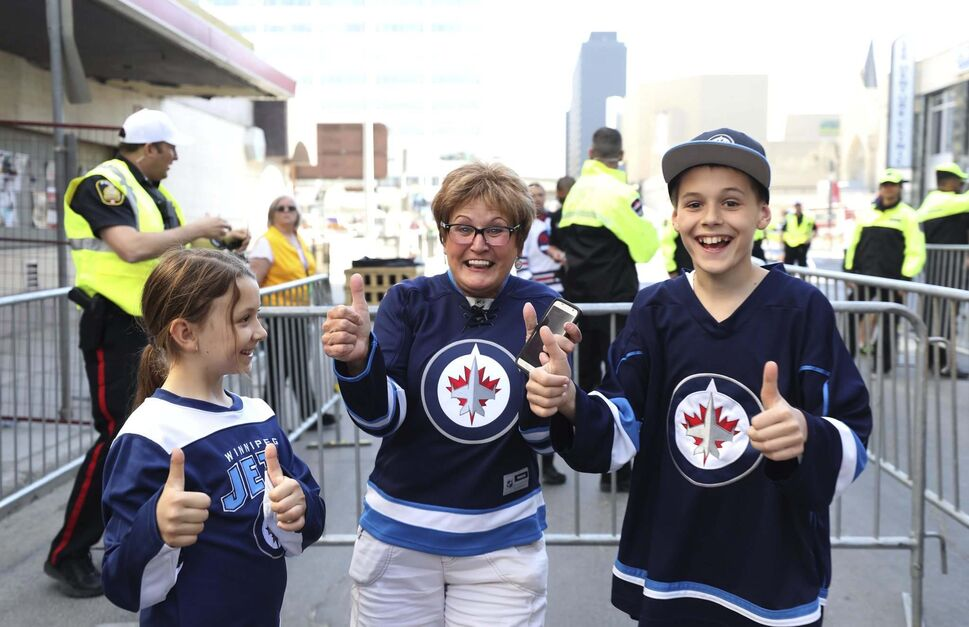 Alice Bourgouin and her two grandchildren Brady, 12, and Hannah, 9, can't hold back their excitement when they were allowed in to the Whiteout street party Saturday. (Ruth Bonneville / Winnipeg Free Press)