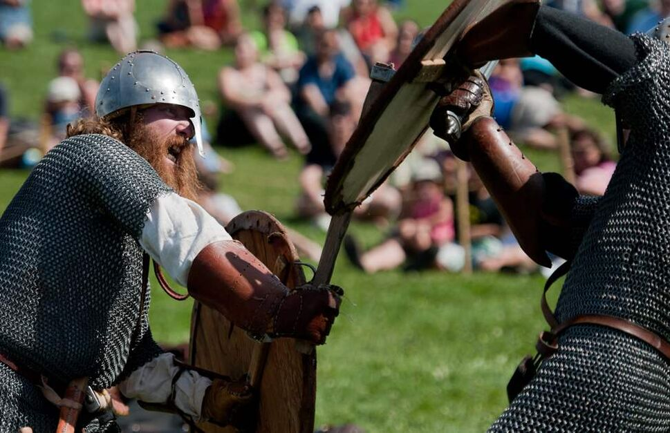 Viking actor James Welbourne repeatedly pummels the shield of Jay Clark in a combat demonstration at the Manitoba Icelandic Festival in Gimli. August 6 2012. (COLE BREILAND / WINNIPEG FREE PRESS)