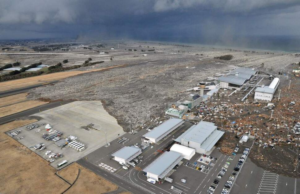 A tsumani triggered by a powerful earthquake makes its way to sweep part of Sendai airport in northern Japan on Friday March 11, 2011. The magnitude 8.9 earthquake slammed Japan's eastern coast Friday, unleashing a 13-foot (4-meter) tsunami that swept boats, cars, buildings and tons of debris miles inland.  (AP Photo/Kyodo News)