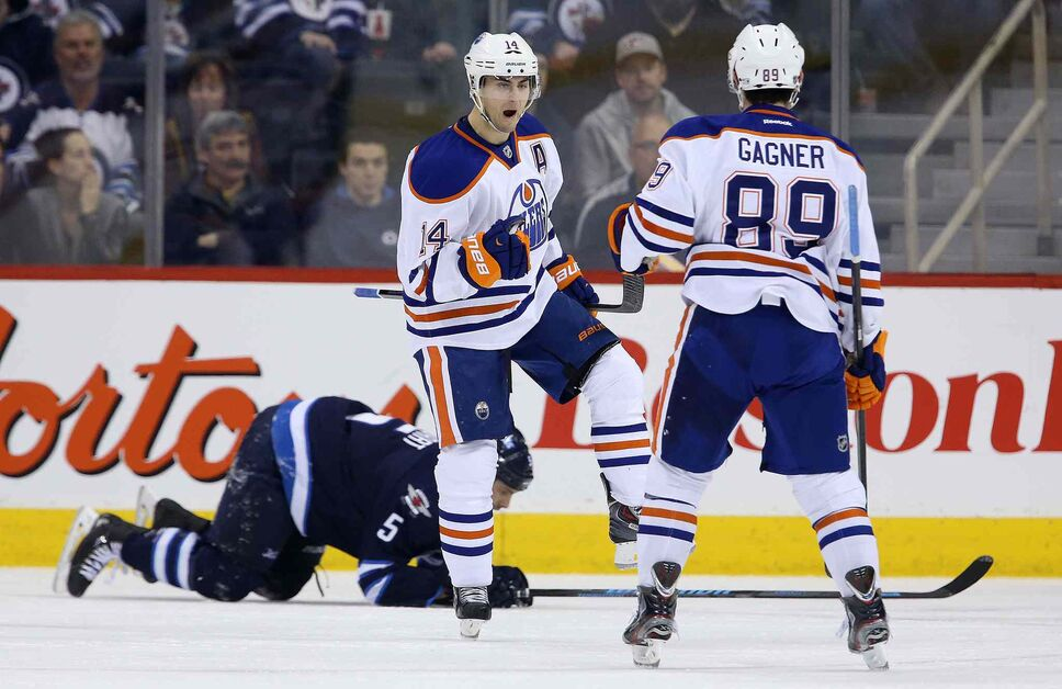 Edmonton Oilers' Jordan Eberle (14) celebrates with Sam Gagner (89) after scoring against the Winnipeg Jets during NHL hockey action at MTS Centre in Winnipeg Saturday. (Trevor Hagan / Winnipeg Free Press)