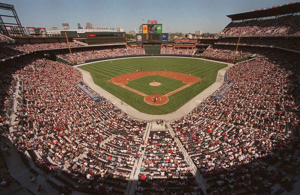 This is a March 29, 1997 file photo of baseball fans as they fill the stands as the Atlanta Braves play an exhibition game against the New York Yankees, the first baseball game ever to be played in the new Turner Field in Atlanta. Converting the Olympic Stadium to a baseball park helped to keep the Braves in downtown Atlanta.  (RIC FELD / The Associated Press)