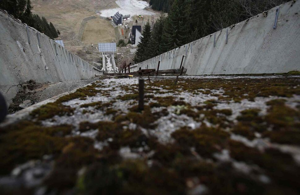 The abandoned ski jumping facility is seen covered in moss at Mt. Igman near Bosnian capital of Sarajevo.  Just eight years after the 1884 Olympics, the bobsleigh and luge track on Mount Trbevic was turned into an artillery position from which Bosnian Serbs pounded the city for almost four years. Today, the abandoned concrete construction looks like a skeleton littered with graffiti. (Amel Emric / The Associated Press)