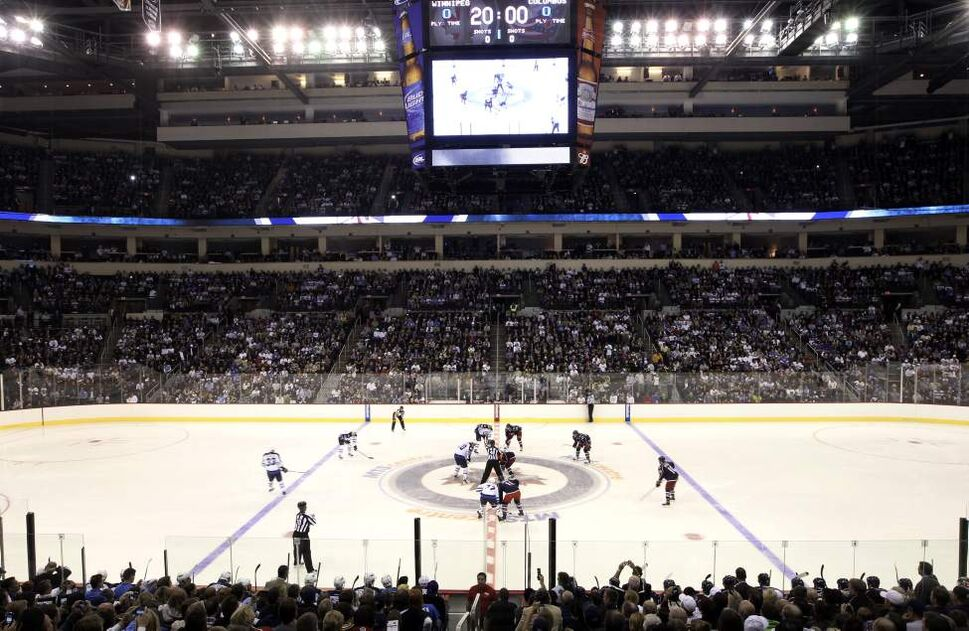 The Winnipeg Jets face-off against the Columbus Blue Jackets at the MTS Center in Winnipeg during pre-season NHL action-The Winnipeg Jets returned to Winnipeg after a 15 year drought since 1996 when the team relocated to  Phoenix. (JOE BRYKSA / WINNIPEG FREE PRESS)