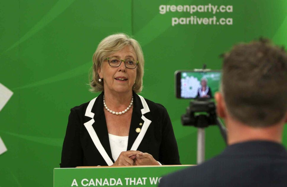 Twitter Canada, Steve Ladurantaye, records Green Party leader Elizabeth May, on his smartphone, to be uploaded to Twitter as she live-tweets to leaders during the Globe and Mail leaders' debate, in Victoria, B.C., on Thursday. (Chad Hipolito / THE CANADIAN PRESS)
