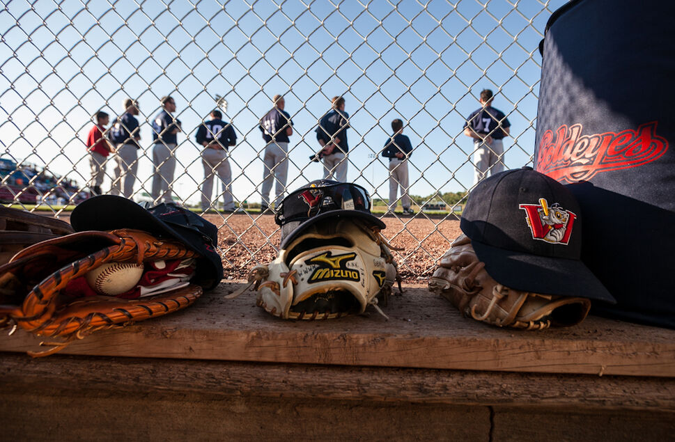 Goldeyes line up for the anthem at the start of the Saturday game at Lewis and Clark stadium in Sioux City. (Melissa Tait / Winnipeg Free Press)