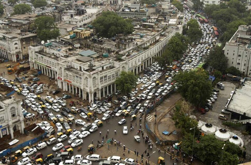 Streets are packed in heavy traffic following power outages and rains in the central part of New Delhi, India. India's energy crisis spread over half the country Tuesday when both its eastern and northern electricity gridscollapsed, leaving 600 million people without power in one of the world's biggest-ever blackout. (AP Photo/Rajesh Kumar Singh)