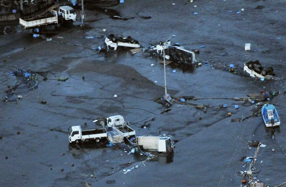 Vehicles remain overturned at Oarai town, Ibaraki prefecture (state), Japan, after a ferocious tsunami spawned by one of the largest earthquakes ever recorded, slammed Japan's eastern coasts Friday, March 11, 2011. (AP Photo/Kyodo News)