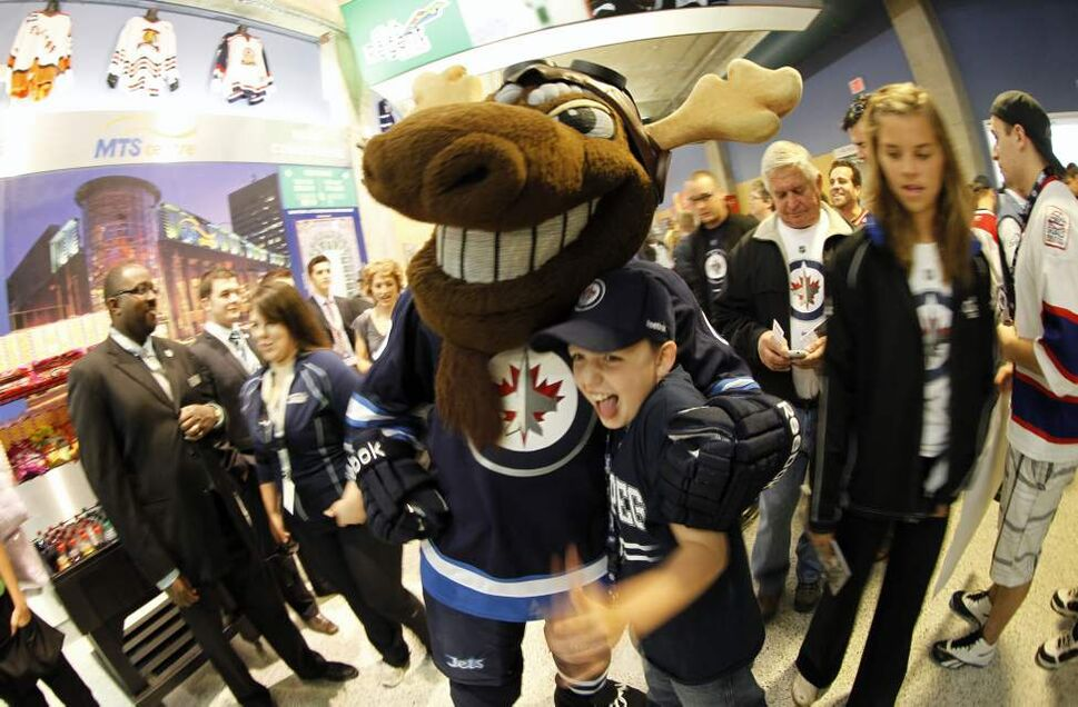 The first Winnipeg Jets fans file into the MTS Centre and Ethan Bewer, 9, meets Jets mascot Mick E. Moose. (Trevor Hagan / Winnipeg Free Press)