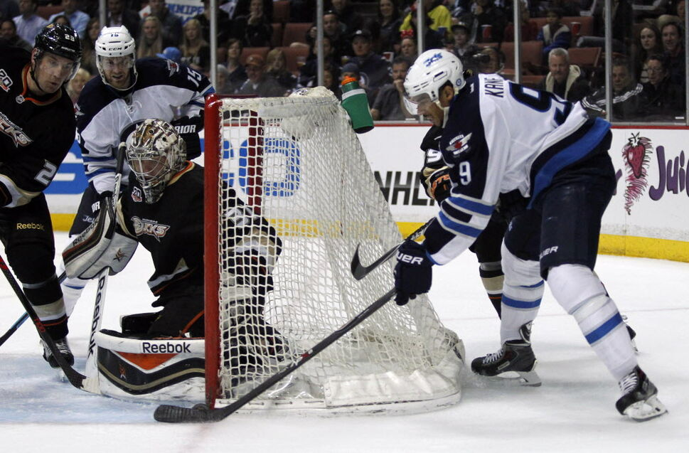 Winnipeg Jets' left wing Evander Kane (9) wraps a first-period shot against Anaheim Ducks' goalie Frederik Andersen during Monday's game in Anaheim. (Alex Gallardo / The Associated Press)