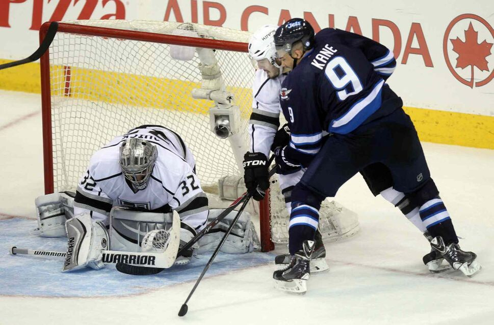 Goalie Jonathan Quick covers up Kanes first attempt in the third period. (Phil Hossack / Winnipeg Free Press)
