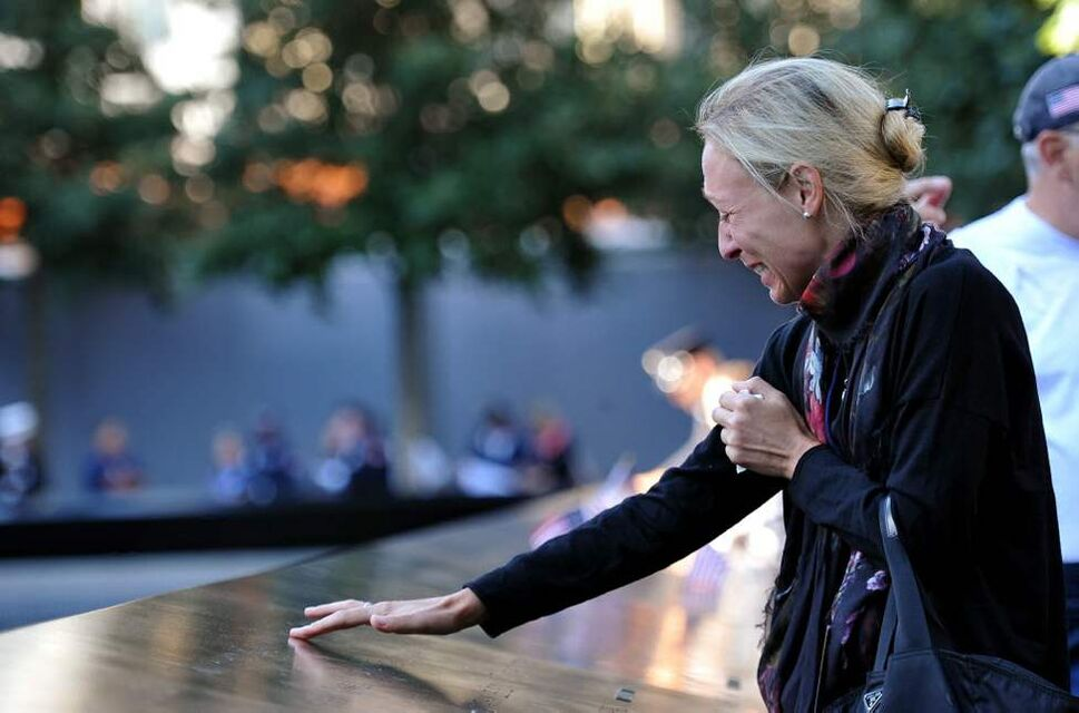 Alicia Watkins remembers a friend who died at the Pentagon during a ceremony marking the 11th anniversary of the Sept. 11 attacks at the National September 11 Memorial at the World Trade Center site in New York. (AP Photo/The Daily News, Todd Maisel, Pool)