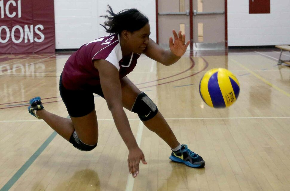 DMCI Maroons' Jada Gibbs tries to get to a ball before it goes out of bounds during the third set. (TREVOR HAGAN / WINNIPEG FREE PRESS)