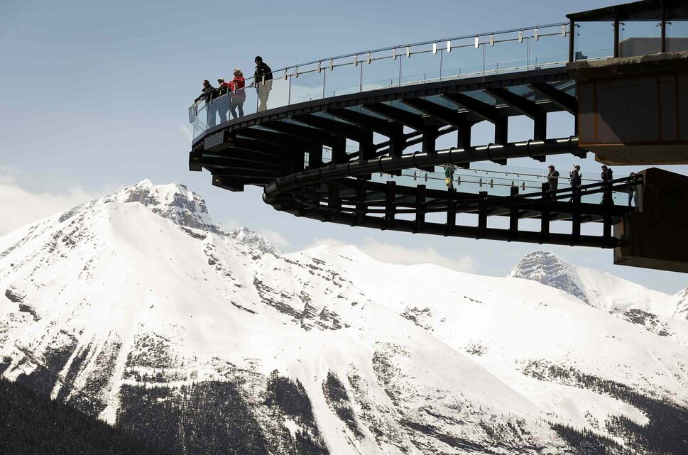 Tourists take in the views from the newly opened Glacier SkyWalk near the Columbia Icefields in Jasper National Park in Alberta. (Jeff McIntosh / The Canadian Press)